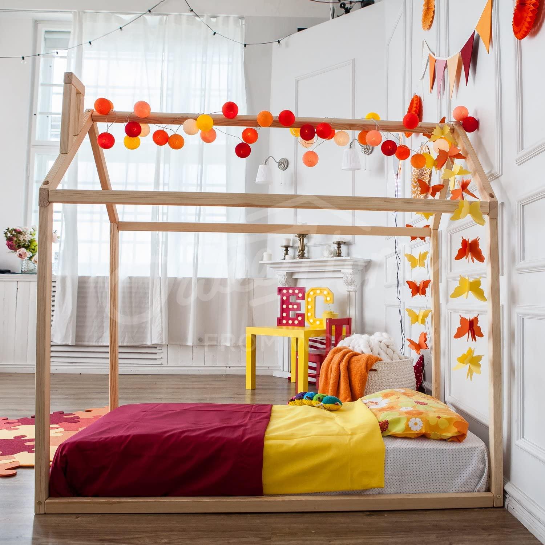cama montessori con chimenea